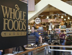 This is a view inside the Whole Foods main store showing the company logo, Friday, Aug. 24, 2007, in Austin, Texas. A federal appeals court on Thursday, Aug. 23, 2007, cleared the way for Whole Foods Market Inc. to buy rival organic grocer Wild Oats Markets Inc. (AP Photo/Harry Cabluck)